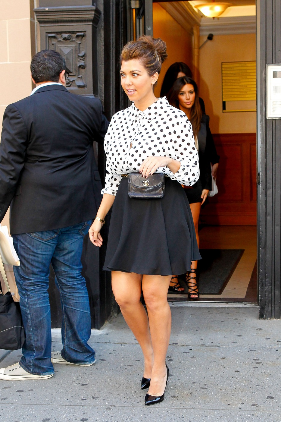 Kourtney, Kim, and Khloe Kardashian leave a building in Midtown Manhattan as they hit the promotional circuit together